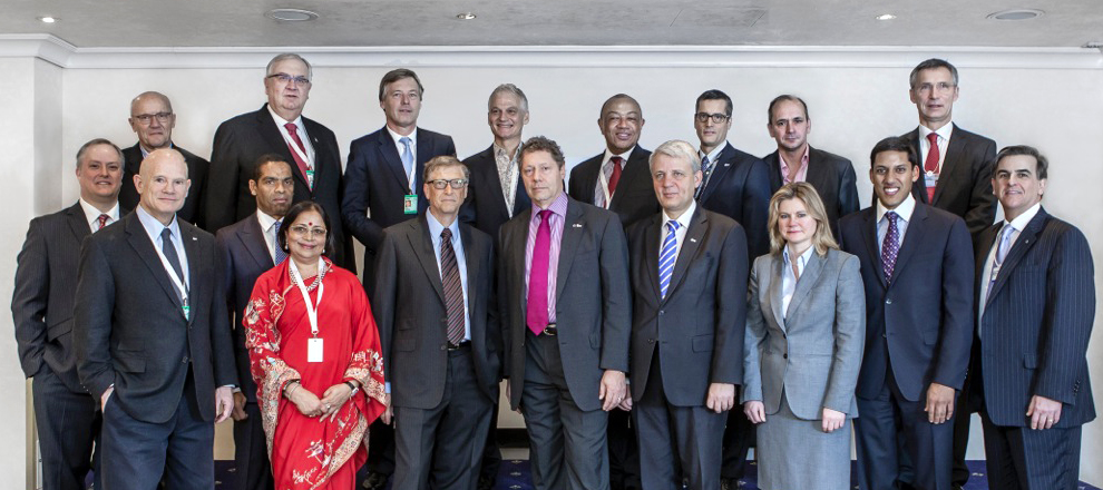 Dr Alvaro Sobrinho with Bill Gates and senior members of the GAVI Alliance
