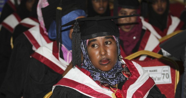 A girl looks on as she attends her graduation ceremony, along with 600 other students of SIMAD University, in Mogadishu